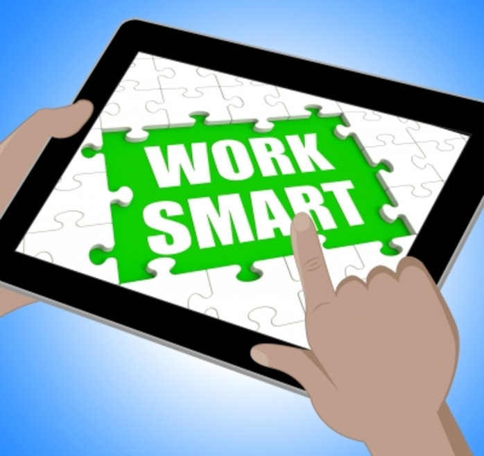 A computer tablet with 'work smart' on it