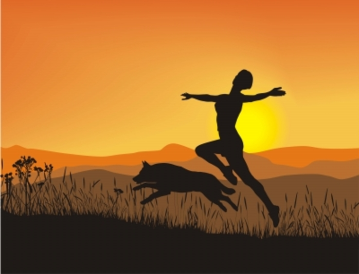 A girl jumping high with her dog at sunset