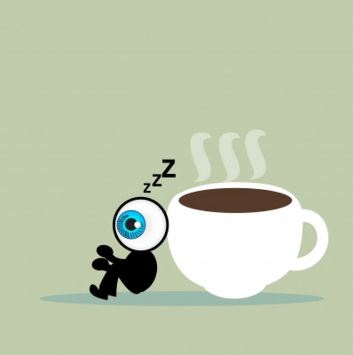 A little 'eye' man next to a cup of coffee