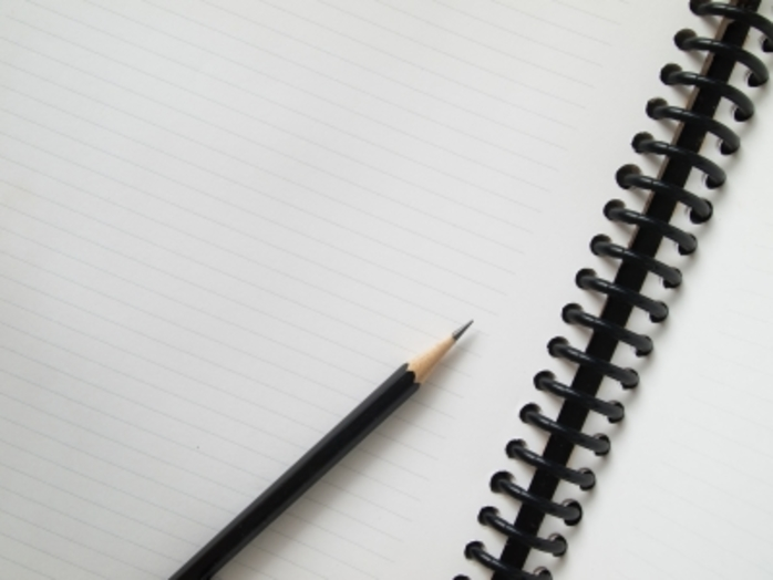 A pencil and notepad