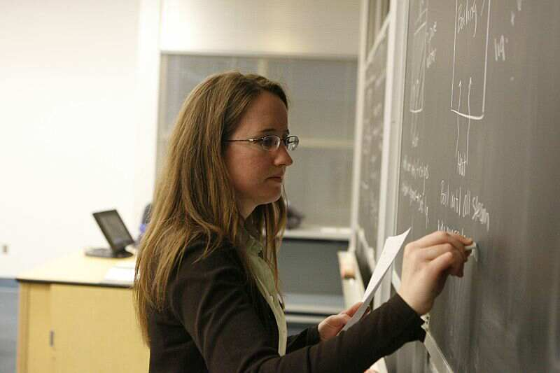 A teacher writing on the board  - Everyone Has a Contribution