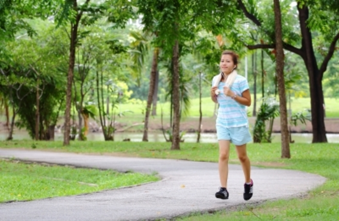 A lady jogging in nature