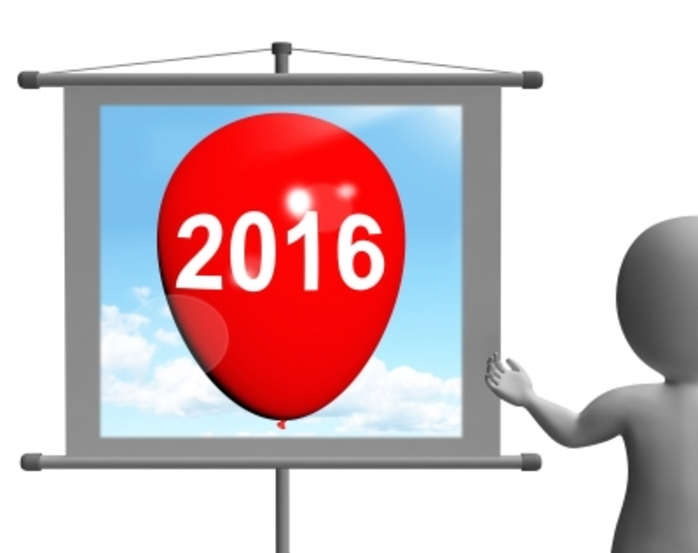a man looking at a balloon that has 2016 on it