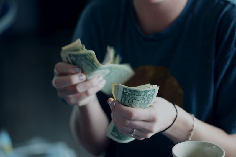 counting money  - Managing Money After Graduation: Part 2