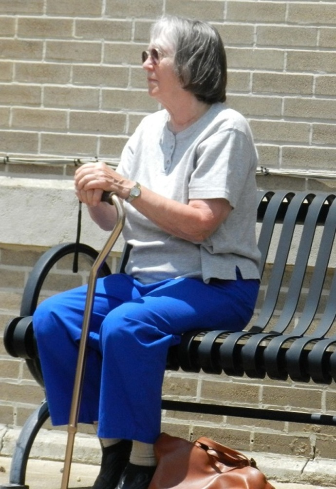 Elderly Woman Sittin on Bench