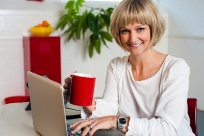 Happy woman with laptop