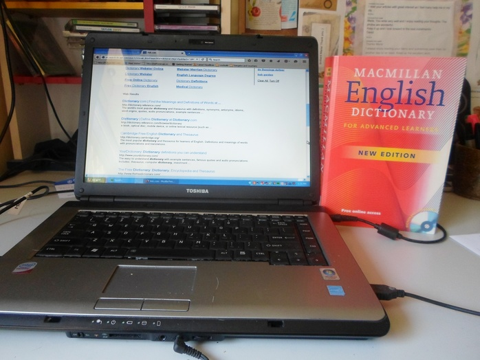 Laptop And Dictionary