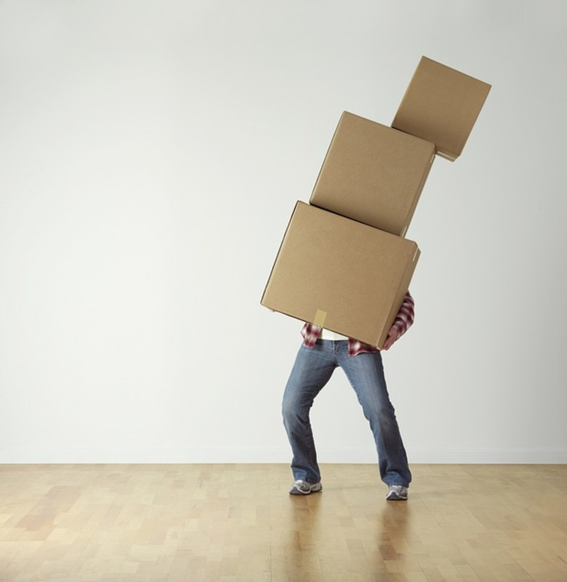 man holding boxes