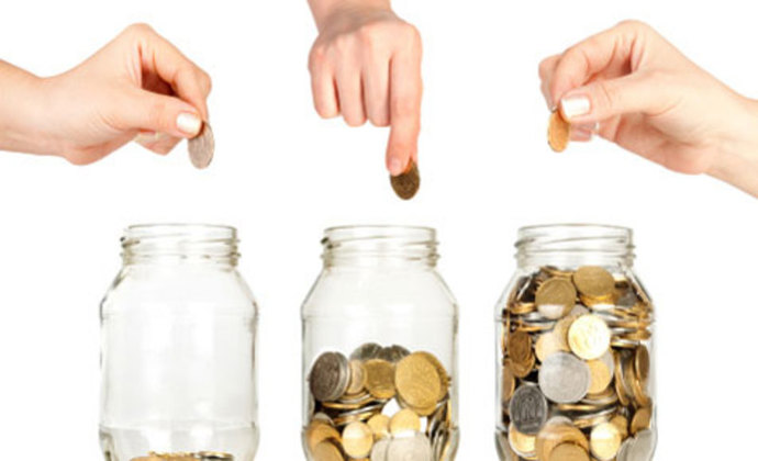 Woman with piggy bank, woman saving coins