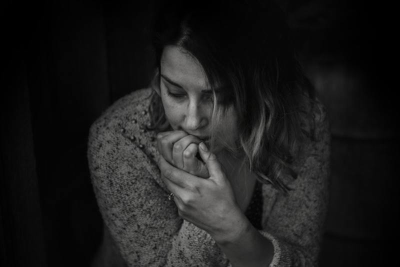 pensive woman  - Managing Your Emotions After A Serious Diagnosis