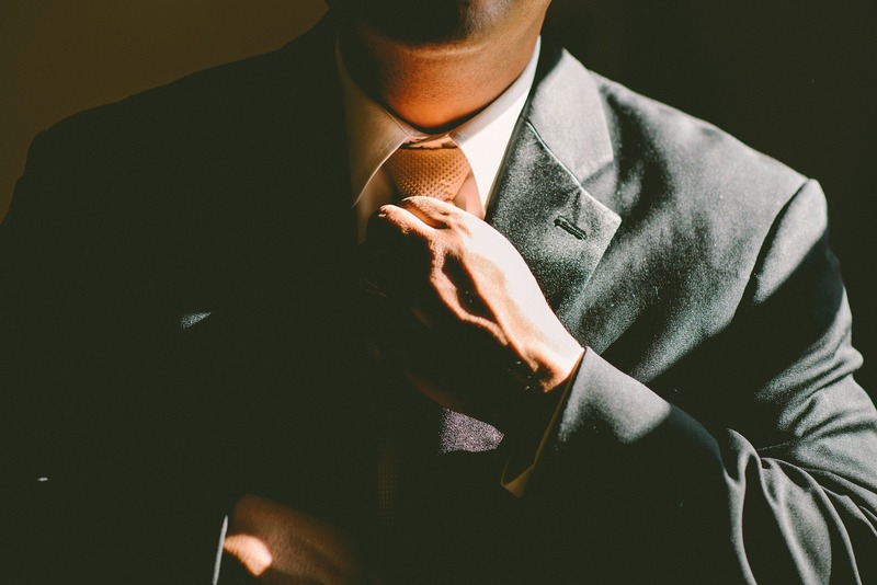 person adjusting tie  - How To Find Your Dream Job