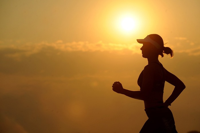 running woman fitness sunset