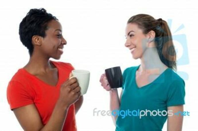Two women enjoying coffee