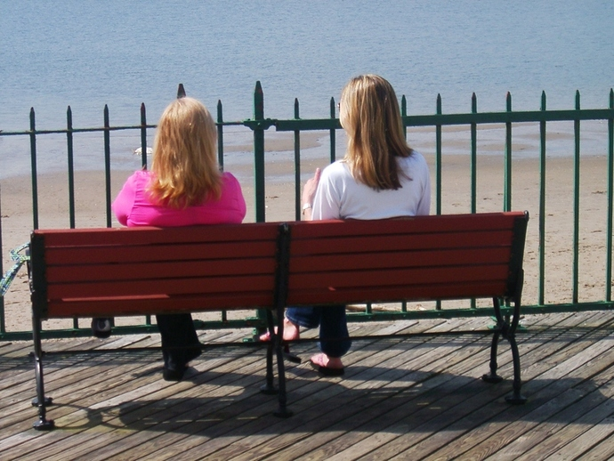 Two Women Sitting On Bench.