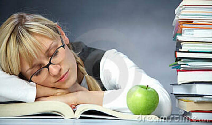 woman falling asleep near books