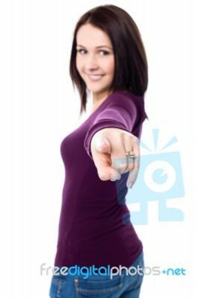 Young woman pointing